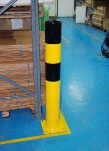 Image of a black and yellow striped protection post